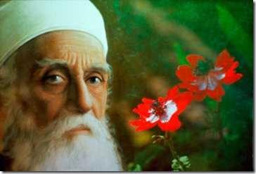 bah01abdul-baha-with-flowers